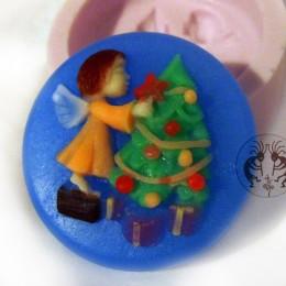 Angel dresses up Christmas tree