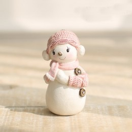 Snowman girl in a knitted hat